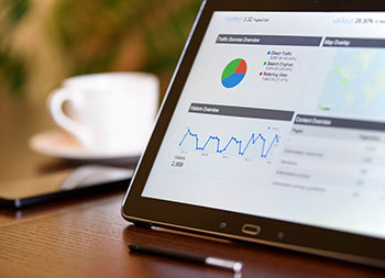 SEO services - site analysis metrics on tablet screen